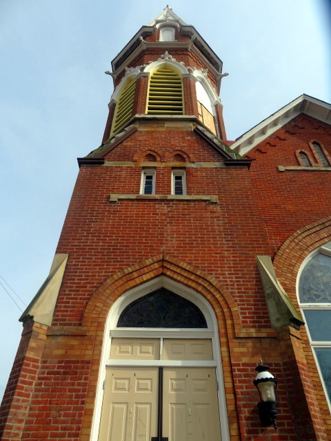 The historic 1895 bell tower atop the Gahanna Sanctuary with two arches completed